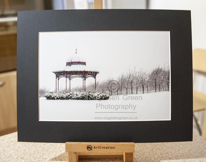 Magdalen Green Bandstand Snow Scene A4 Mounted print
